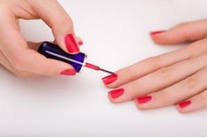 Manicure process. Beautiful female hands.