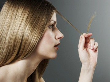 Woman Examining Split Ends